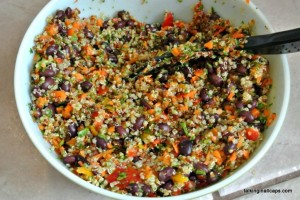 Kale, Quinoa and Black Bean Salad -12 Great Salads to Take to a Potluck or Feed a Big Group - talkinginallcaps.com